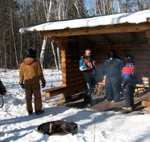 A warming fire and three-sided trailside rest stop offered a chance for veterans and their hosts to chat trailside.