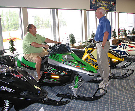 Summertime visitors to the World Snowmobile Headquarters see the latest sleds alongside vintage ones.