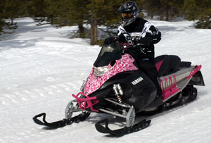 "Yamaha's ""pinky"" accessorized sled demonstrates the wide range of dealer available add-ons."