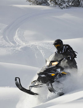 Ski-Doo's lightweight REV–XP chassis puts the Summit on top of the snow.