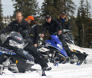 Brett Rasmussen, at left, welcomes all brands of snowmobilers to tap into his knowledge of powder riding.